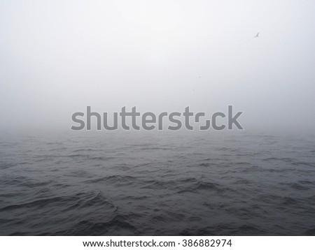 misty fog over sea with sun - stock photo