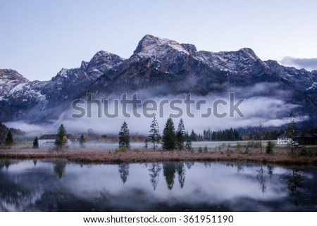 Misty foggy mountain landscape with swamp in Almsee lake, Austria - stock photo
