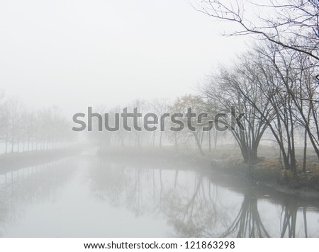 Misty lake in morning - stock photo