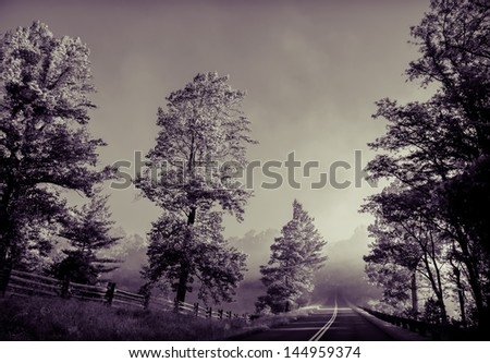 misty morning in blue ridge mountains - stock photo