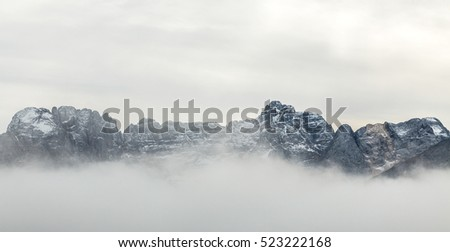 Misty morning scene in The Dolomites Alps mountains, Italy