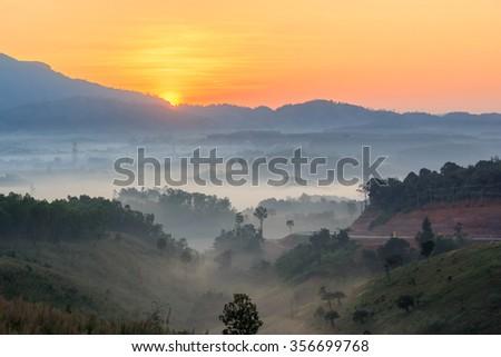 misty morning sunrise in mountain  - stock photo