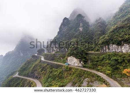 Misty morning view of dangerous mountain roads in China.