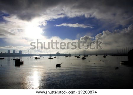 misty morning with boats and with the eye in the sky, Plymouth, UK - stock photo