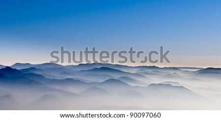 Misty mountain hills - stock photo