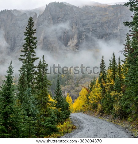 Misty Mountain Trail - Square - A foggy and rainy autumn view of a rugged mountain road - Black Bear Pass Trail, near Telluride, Colorado, USA. - stock photo