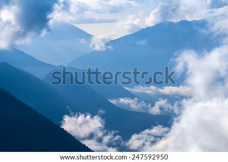 misty mountain valley - stock photo