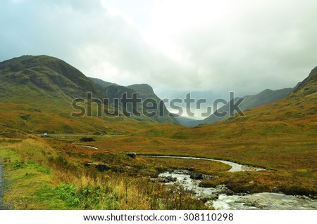 Misty mountains in the Scottish Highlands - stock photo