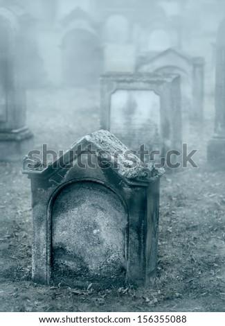 Misty mystery cemetery - stock photo