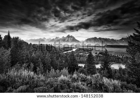 Misty pre-dawn view of the Snake River Valley in the Tetons - stock photo