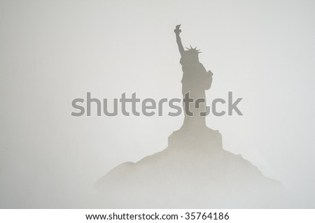 misty shadow of lady liberty statue on a hill