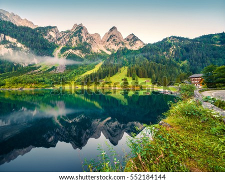 Misty summer morning on the Vorderer Gosausee lake. Colorful outdoor scene in Austrian Alps, Salzkammergut resort area in the Gosau Valley in Upper Austria, Europe. Artistic style post processed photo