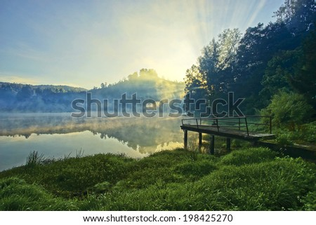 Misty sunrise at Ranu Pane, base-camp at Semeru Volcano Mountain, East Java, Indonesia. Semeru Mountain also known as Mahameru Mountain in Indonesia means the great mountain.  - stock photo