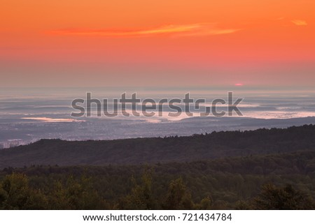 Misty sunrise over the valley, beautiful summer landscape