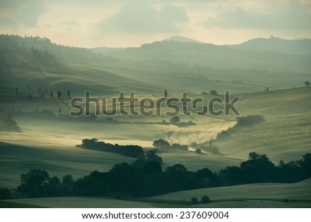 Misty Tuscan hills one early morning town of Pienza ,Italy - stock photo