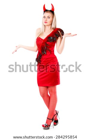 Misunderstanding young woman in a devil costume isolated over white background