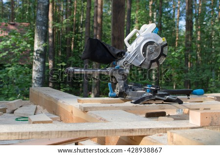 miter saw in building area. tools in wooden house. building ecological house