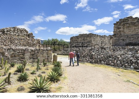 Mitla, Oaxaca, Mexico - Oct 10, 2015: Tourists walk through Mitla archaeological site, Oaxaca, Mexico