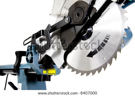 Mitre Saw in White Background, Blade Teeth in Focus - stock photo
