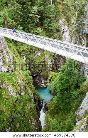 MITTENWALD, GERMANY - JULY 9: People hiking through Leutasch gorge in Mittenwald, Germany on July 9, 2016. The gorge is open for tourists since 2006 - stock photo