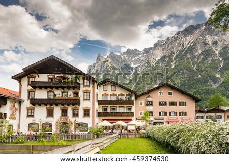 MITTENWALD, GERMANY - MAY 27: Historic houses in the village of Mittenwald, Germany on May 27, 2016. Mittenwald is famous for the manufacture of violins, violas and cellos.  - stock photo