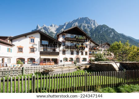 MITTENWALD, GERMANY - SEPTEMBER 27: Shops in the village of Mittenwald, Germany on September 27, 2014. Mittenwald is famous for the manufacture of violins, violas and cellos. - stock photo