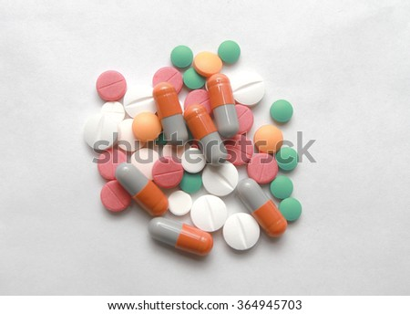 MIULTI COLOURED PILLS ON WHITE BACKGROUND