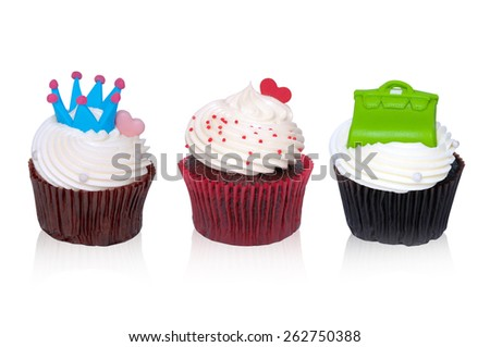 Mix chocolate cupcake Creamy white, green bag, red heart,  Blue Crown on white background. - stock photo