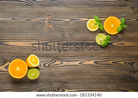 Mix citrus fresh fruit on the white wooden table, top view - stock photo