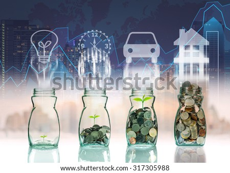 Mix coins and seed in clear bottle on trading graph with cityscape background with sign shape,Business investment growth concept - stock photo