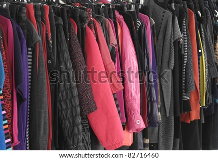 Mix color in autumn/winter fashion clothing on hanging background