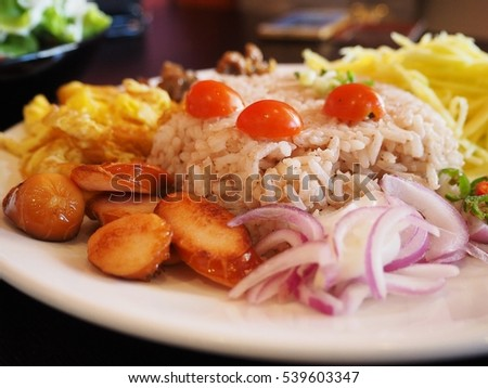 Mix cooked rice with shrimp paste sauce and fresh vegetables, eggs, pork and sweet.
