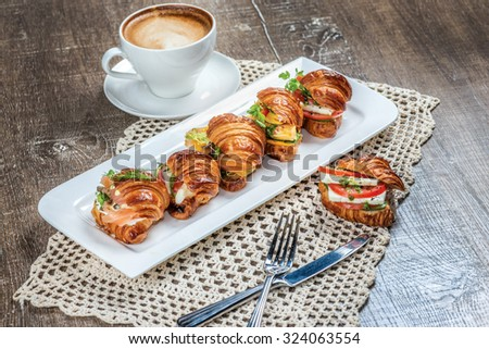 Mix Croissants with cheese feta and mozzarella, smoked salmon and fried egg and smoked turkey, pesto and roasted zucchini and bell pepper. - stock photo