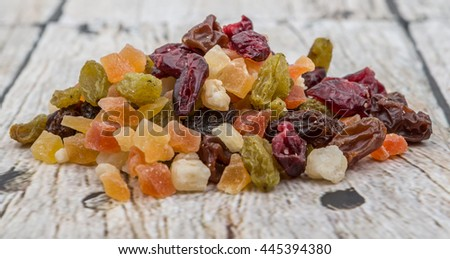 Mix dried fruit pieces over white background