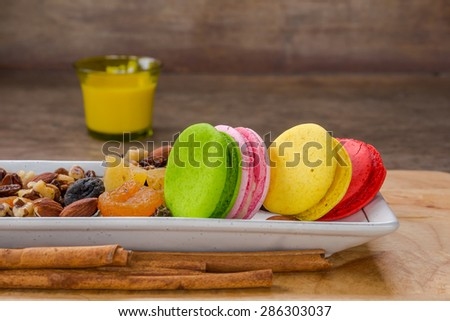 mix dried fruits and colorful macaroons