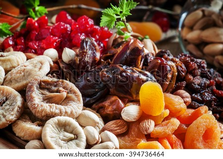 Mix dried fruits and nuts, healthy diet, eating lean, old wooden background, selective focus - stock photo