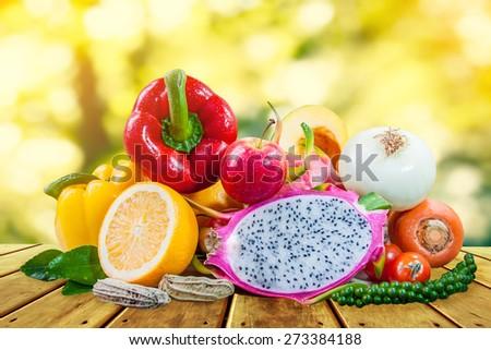 mix fresh fruits and vegetable design on wood background - stock photo