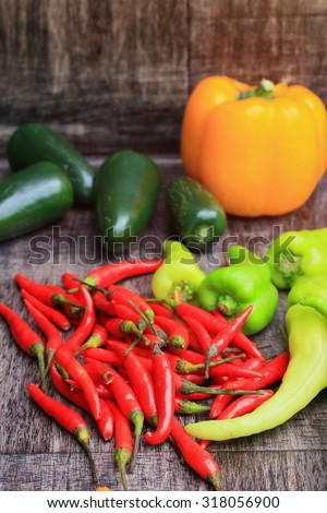 mix fresh green bell pepper and red on wood vintage background