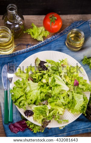 mix fresh salad from summer vegetables with oil in dish
