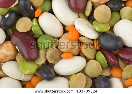 Mix from different beans: green and red football lentils, black, brown and white legume, split green pea and chickpeas - stock photo