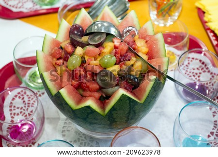 Mix fruit in a bowl from a water-mellon. - stock photo