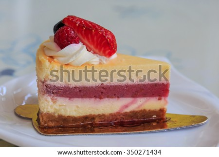 mix fruits and berry cake on white dish