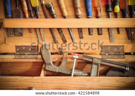 Mix maintenance tools in wooden box - stock photo