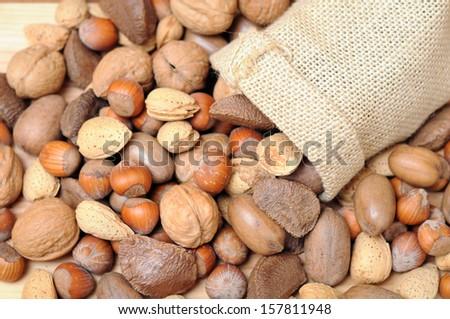 mix nut with burlap sack  - stock photo