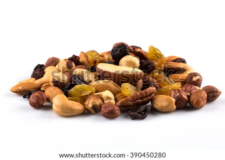 Mix nuts and dry fruits  on a white background - stock photo