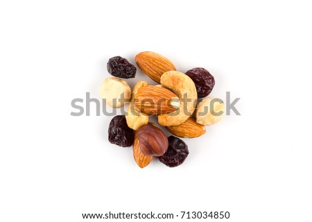 Mix nuts, dry fruits and grapes on a white background