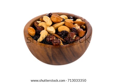 Mix nuts, dry fruits and grapes on a white background in bowl