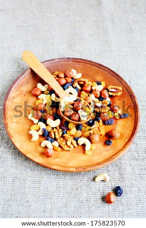 Mix nuts on a platter, food closeup - stock photo