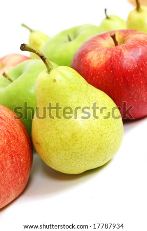 Mix of apples and pears on white - stock photo