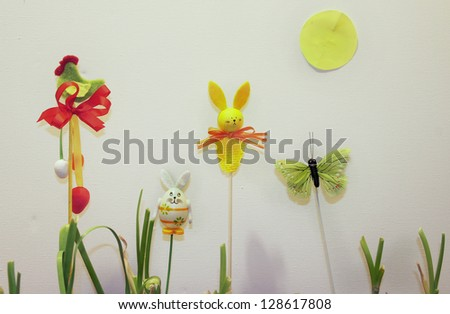 Mix of beautiful handmade Easter colored toys - stock photo